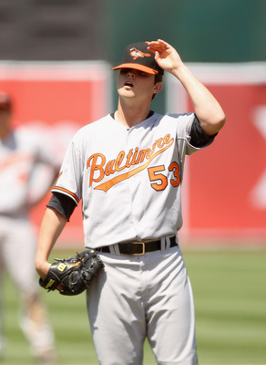 OAKLAND, CA - MAY 29:  Zach Britton #53 of the Baltimore Orioles reacts after giving up a run in the fifth inning to the Oakland Athletics at Oakland-Alameda County Coliseum on May 29, 2011 in Oakland, California.  (Photo by Ezra Shaw/Getty Images)