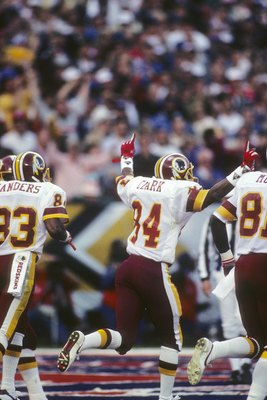 SAN DIEGO - JANUARY 31:  Wide receiver Gary Clark #84 (C) of the Washington Redskins celebrates his touchdown during Super Bowl XXII against the Denver Broncos at Jack Murphy Stadium on January 31, 1988 in San Diego, California.  The Redskins won 42-10.