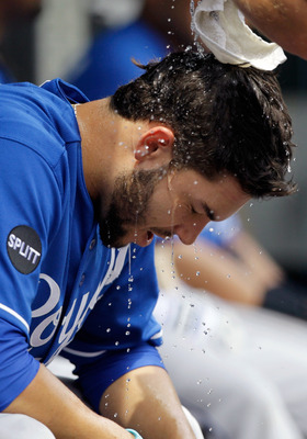 BALTIMORE, MD - MAY 26: Eric Hosmer #35 of the Kansas City Royals has water poured on his head by a trainer between innings against the Baltimore Orioles  at Oriole Park at Camden Yards on May 26, 2011 in Baltimore, Maryland.  (Photo by Rob Carr/Getty Ima