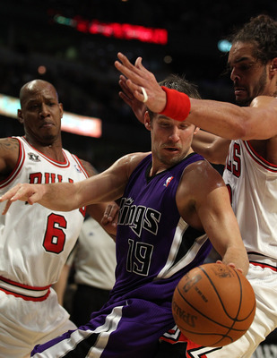 CHICAGO, IL - MARCH 21: Beno Udrih #19 of the Sacramento Kings tries to moves under pressure from Joakim Noah #13 and Keith Bogans #6 of the Chicago Bulls at the United Center on March 21, 2011 in Chicago, Illinois. The Bulls defeated the Kings 132-92. NO