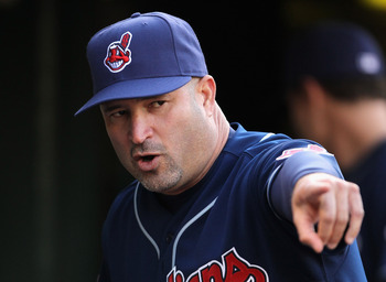 OAKLAND, CA - MAY 03:  Manager Manny Acta of the Cleveland Indians stands in the dugout before their game against the Oakland Athletics at Oakland-Alameda County Coliseum on May 3, 2011 in Oakland, California.  (Photo by Ezra Shaw/Getty Images)