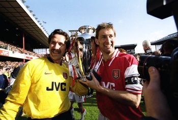 3 May 1998:  David Seaman of Arsenal and club captain Tony Adams hold the championship trophy after the FA Carling Premiership match against Everton at Highbury in London. David Seaman, who was capped 75 times for England, announced his decision to retire