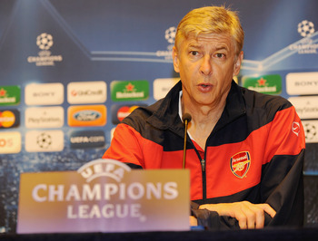 AMSTERDAM, NETHERLANDS - OCTOBER 19:  Arsene Wenger, manager of Arsenal, talks to the media during a press conference at the Sheraton Amsterdam Airport Hotel on October 19, 2009 in Amsterdam, Netherlands.  (Photo by Michael Regan/Getty Images)