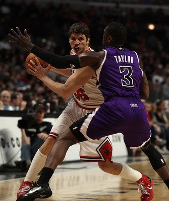 CHICAGO, IL - MARCH 21: Kyle Korver ##26 of the Chicago Bulls looks to pass under pressure from Jermaine Taylor #3 of the Sacramento Kings at the United Center on March 21, 2011 in Chicago, Illinois. The Bulls defeated the Kings 132-92. NOTE TO USER: User