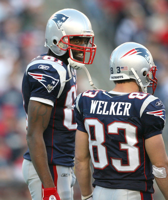 FOXBORO, MA - NOVEMBER 8:  Randy Moss #81 of the New England Patriots reacts with teammate Wes Welker #83 during a game against the Miami Dolphins at Gillette Stadium on November 8, 2009 in Foxboro, Massachusetts. The Patriots won 27-17. (Photo by Jim Rog