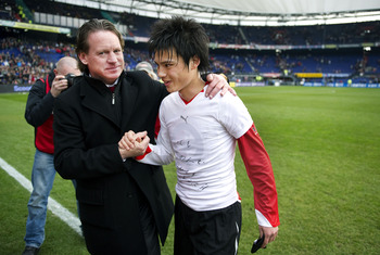 ROTTERDAM, NETHERLANDS - MARCH 13:  Ryo Miyaichi shakes hands with Feyenoord coach Mario Been (L) after the Eredivisie match between Feyenoord and NAC at the Kuip on March 13, 2011 in Rotterdam, Netherlands.  (Photo by Olaf Kraak/Getty Images)