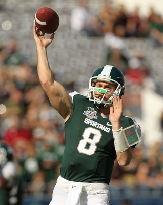 ORLANDO, FL - JANUARY 01: Kirk Cousins #8  of the Michigan State Spartans warms up during the Capitol One Bowl against the Alabama Crimson Tide at the Florida Citrus Bowl on January 1, 2011 in Orlando, Florida.  (Photo by Mike Ehrmann/Getty Images)