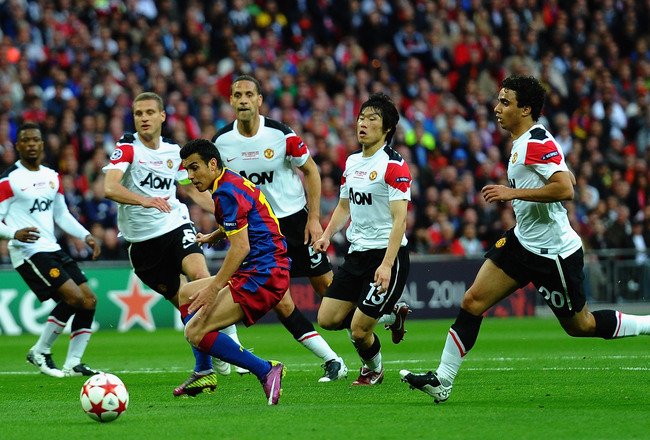 LONDON, ENGLAND - MAY 28: Pedro of FC Barcelona controls the ball as the Manchester United defense look on  during the UEFA Champions League final between FC Barcelona and Manchester United FC at Wembley Stadium on May 28, 2011 in London, England.  (Photo