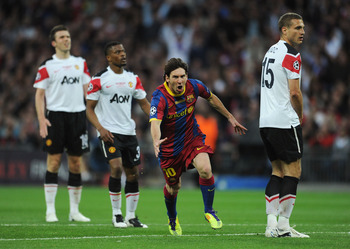 LONDON, ENGLAND - MAY 28:  Lionel Messi of FC Barcelona (2L) celebrates scoring his teams second goal during the UEFA Champions League final between FC Barcelona and Manchester United FC at Wembley Stadium on May 28, 2011 in London, England.  (Photo by Ja