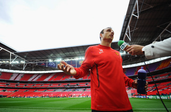 LONDON, ENGLAND - MAY 27:  Dimitar Berbatov of Manchester United speaks to the media after a Manchester United training session prior to the UEFA Champions League final versus Barcelona at Wembley Stadium on May 27, 2011 in London, England.  (Photo by Cli