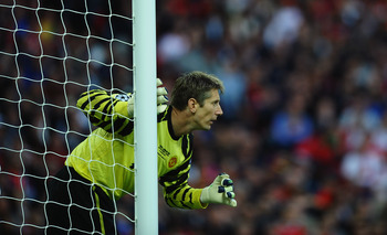 LONDON, ENGLAND - MAY 28:  Edwin van der Sar  of Manchester United looks on during the UEFA Champions League final between FC Barcelona and Manchester United FC at Wembley Stadium on May 28, 2011 in London, England.  (Photo by Laurence Griffiths/Getty Ima