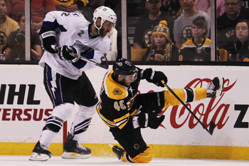 BOSTON, MA - MAY 27:  Eric Brewer #2 of the Tampa Bay Lightning knocks David Krejci #46 of the Boston Bruins to the ice in the second period of Game Seven of the Eastern Conference Finals during the 2011 NHL Stanley Cup Playoffs at TD Garden on May 27, 20