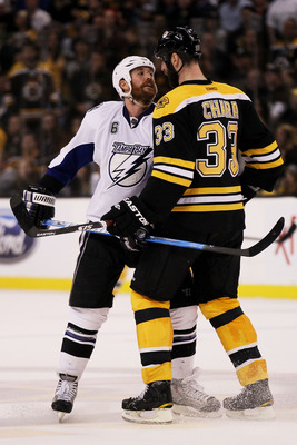 BOSTON, MA - MAY 23:  Ryan Malone #6 of the Tampa Bay Lightning and Zdeno Chara #33 of the Boston Bruins exchange words in Game Five of the Eastern Conference Finals during the 2011 NHL Stanley Cup Playoffs at TD Garden on May 23, 2011 in Boston, Massachu