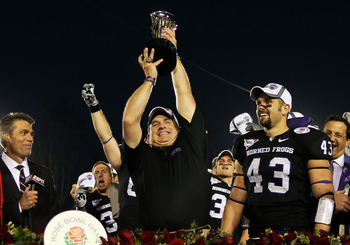 PASADENA, CA - JANUARY 01:  Head coach Gary Patterson of the TCU Horned Frogs holds the Rose Bowl Championship Trophy after defeating the Wisconsin Badgers 21-19 in the 97th Rose Bowl game on January 1, 2011 in Pasadena, California.  (Photo by Jeff Gross/