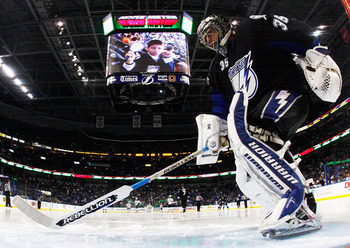 TAMPA, FL - MAY 25:  Dwayne Roloson #35 of the Tampa Bay Lightning defends against the Boston Bruins in Game Six of the Eastern Conference Finals during the 2011 NHL Stanley Cup Playoffs at St Pete Times Forum on May 25, 2011 in Tampa, Florida.  (Photo by