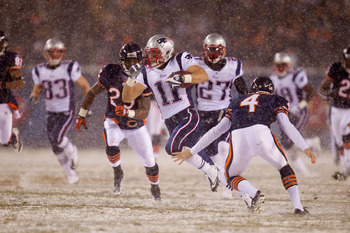 CHICAGO, IL - DECEMBER 12: Julian Edelman #11 of the New England Patriots returns a kick against the Chicago Bears at Soldier Field on December 12, 2010 in Chicago, Illinois.  The Patriots beat the Bears 36-7.  (Photo by Dilip Vishwanat/Getty Images)