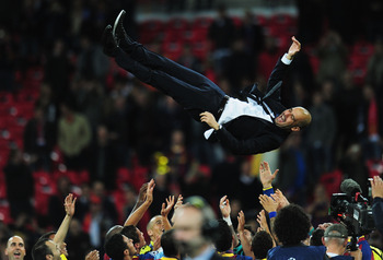 LONDON, ENGLAND - MAY 28:  Josep Guardiola manager of FC Barcelona is thrown in the air as Barcelona celebrate victory in UEFA Champions League final between FC Barcelona and Manchester United FC at Wembley Stadium on May 28, 2011 in London, England.  (Ph
