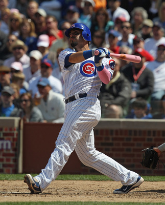 CHICAGO, IL - MAY 08: Geovany Soto #18 of the Chicago Cubs takes a swing against the Cincinnati Reds at Wrigley Field on May 8, 2011 in Chicago, Illinois. The Reds defeated the Cubs 2-0. (Photo by Jonathan Daniel/Getty Images)
