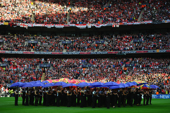 LONDON, ENGLAND - MAY 28:  Dancers perform ahead of the UEFA Champions League final between FC Barcelona and Manchester United FC at Wembley Stadium on May 28, 2011 in London, England.  (Photo by Laurence Griffiths/Getty Images)