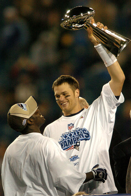 Tom Brady holds the Vince Lombardi Trophy as he stands on the podium with Deion Branch after The New England Patriots defeated The Philadelphia Eagles in Super Bowl XXXIX at Alltel Staduim in Jacksonville, Florida. (Photo by Steve Grayson/Getty Images)