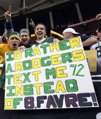 ATLANTA, GA - JANUARY 15:  Fans of the Green Bay Packers hold up a sign which reads 'I'd Rather Aaron Rodgers text me instead of Brett Favre after the Packers defeated the Atlanta Falcons 48-21 during their 2011 NFC divisional playoff game at Georgia Dome