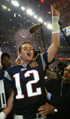 HOUSTON, TX - FEBRUARY 1:  MVP Tom Brady of the New England Patriots celebrates after defeating the Carolina Panthers 32-29 in Super Bowl XXXVIII at Reliant Stadium on February 1, 2004 in Houston, Texas. (Photo by Andy Lyons/Getty Images)