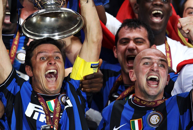 MADRID, SPAIN - MAY 22:  Javier Zanetti of Inter Milan lifts the UEFA Champions League trophy following their team's victory at the end of the UEFA Champions League Final match between FC Bayern Muenchen and Inter Milan at the Estadio Santiago Bernabeu on