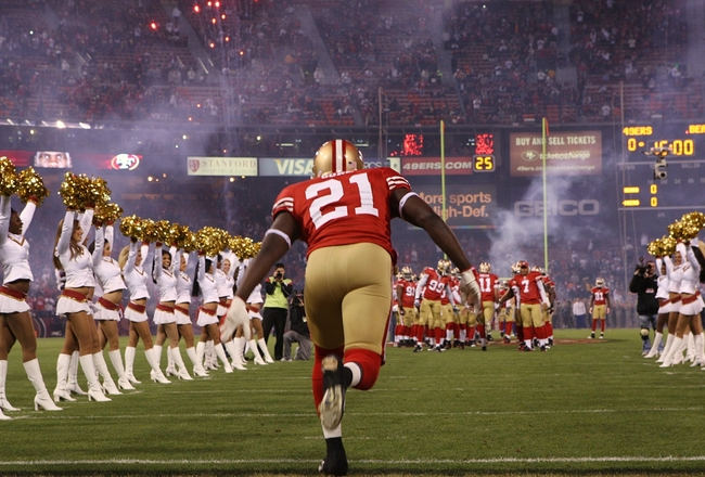 SAN FRANCISCO - NOVEMBER 12:  Frank Gore #21 of the San Francisco 49ers takes the field during player introductions against the Chicago Bears at Candlestick Park on November 12, 2009 in San Francisco, California.  (Photo by Jed Jacobsohn/Getty Images)