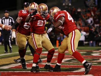 SAN FRANCISCO - DECEMBER 14:  (C) Frank Gore #21 of the San Francisco 49ers celebrates with teammates Adam Snyder #68 and  Moran Norris #44 after Gore scored a two-yard touchdown against the Arizona Cardinals in the fourth quarter at Candlestick Park on D