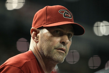 PHOENIX, AZ - MAY 18:  Manager Kirk Gibson of the Arizona Diamondbacks watches from the dugout during the Major League Baseball game against the Atlanta Braves at Chase Field on May 18, 2011 in Phoenix, Arizona. The Diamondbacks defeated the Braves 5-4 in