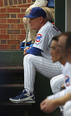 CHICAGO, IL - MAY 29: Manager Mike Quade #8 of the Chicago Cubs watches from the dugout as his team takes on the Pittsburgh Pirates at Wrigley Field on May 29, 2011 in Chicago, Illinois. The Cubs defeated the Pirates 3-2. (Photo by Jonathan Daniel/Getty I