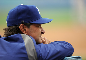 LOS ANGELES, CA - MAY 14:  Manager Don Mattingly of the Los Angeles Dodgers watches play from the dugout against the Arizona Diamondbacks at Dodger Stadium on May 14, 2011 in Los Angeles, California.  (Photo by Harry How/Getty Images)