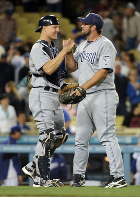 LOS ANGELES, CA - APRIL 30:  Nick Hundley and Heath Bell #21 of the San Diego Padres celebrate a 5-2 win over the Los Angeles Dodgers after the ninth inning at Dodger Stadium on April 30, 2011 in Los Angeles, California.  (Photo by Harry How/Getty Images)
