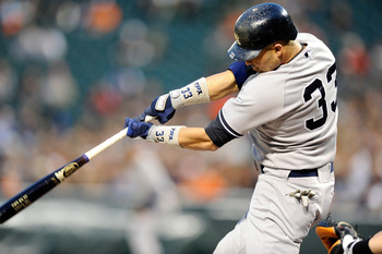 BALTIMORE, MD - MAY 19:  Nick Swisher #33 of the New York Yankees hits a double in the first inning against the Baltimore Orioles at Oriole Park at Camden Yards on May 19, 2011 in Baltimore, Maryland.  (Photo by Greg Fiume/Getty Images)