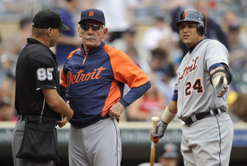MINNEAPOLIS, MN - MAY 11: Manager Jim Leyland #10 of the Detroit Tigers gets between umpire Vic Carapazza #85 and Miguel Cabrera #24 of the Detroit Tigers after Cabrera was ejected by Carapazza during in the sixth inning of their game against the Minnesot