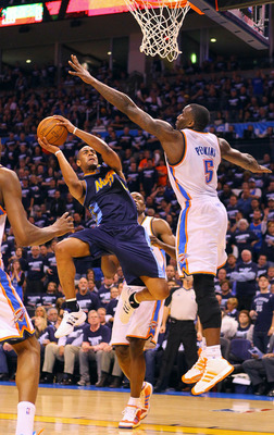 OKLAHOMA CITY, OK - APRIL 27: Arron Afflalo #6 of the Denver Nuggets shoots the ball against Kendrick Perkins #5 of the Oklahoma City Thunder in Game Five of the Western Conference Quarterfinals in the 2011 NBA Playoffs on April 27, 2011 at the Ford Cente