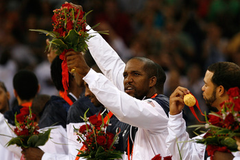 BEIJING - AUGUST 24:  Michael Redd #8 of the United States smiles on the podium after winning the gold medal over Spain in the men's basketball final during Day 16 of the Beijing 2008 Olympic Games at the Beijing Olympic Basketball Gymnasium on August 24,