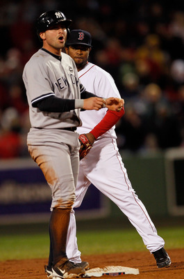 BOSTON - OCTOBER 2: Francisco Cervelli #29 of the New York Yankees reacts after he doubles to knock in a run as Eric Patterson #3 of the Boston Red Sox looks on  Fenway Park, October 2, 2010, in Boston, Massachusetts. (Photo by Jim Rogash/Getty Images)