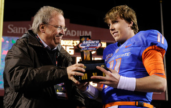 LAS VEGAS, NV - DECEMBER 22:  MAACO President Dave Lapps (L) gives the most valuable player trophy to quarterback Kellen Moore #11 of the Boise State Broncos after the team's 26-3 victory over the Utah Utes in the MAACO Bowl Las Vegas at Sam Boyd Stadium