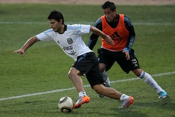 PRETORIA, SOUTH AFRICA - JUNE 28:  Sergio Aguero of Argentina's national football team contests the ball during a team training session on June 28, 2010 in Pretoria, South Africa.  (Photo by Chris McGrath/Getty Images)