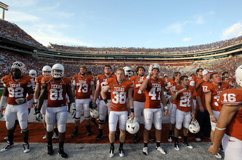AUSTIN, TX - SEPTEMBER 25:  The Texas Longhorns walk off the field after a 34-12 loss against the UCLA Bruins at Darrell K Royal-Texas Memorial Stadium on September 25, 2010 in Austin, Texas.  (Photo by Ronald Martinez/Getty Images)
