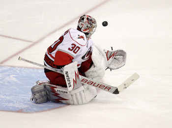 WASHINGTON, DC - MARCH 29:  Goalie Cam Ward #30 of the Carolina Hurricanes blocks a shot on goal during a shootout against the Washington Capitals at the Verizon Center on March 29, 2011 in Washington, DC. (Photo by Rob Carr/Getty Images)