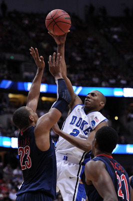 ANAHEIM, CA - MARCH 24:  Nolan Smith #2 of the Duke Blue Devils shoot the ball over Derrick Williams #23 of the Arizona Wildcats during the west regional semifinal of the 2011 NCAA men's basketball tournament at the Honda Center on March 24, 2011 in Anahe