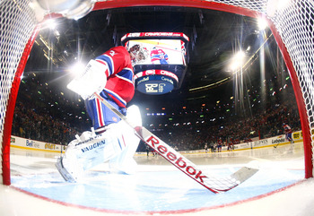MONTREAL, CANADA - APRIL 26:  Carey Price #31 of the Montreal Canadiens prepares his crease at the start of the third period in Game Six of the Eastern Conference Quarterfinals against the Boston Bruins during the 2011 NHL Stanley Cup Playoffs at the Bell