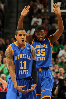 DENVER, CO - MARCH 17:  Terrance Hill #11 of the Morehead State Eagles reacts after hitting a three pointer in the second half as Kenneth Faried #35 looks on against the Louisville Cardinals during the second round of the 2011 NCAA men's basketball tourna