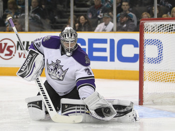 SAN JOSE, CA - APRIL 23:  Jonathan Quick #32 of the Los Angeles Kings makes a save on a shot taken by the San Jose Sharks in game five of the Western Conference Quarterfinals during the 2011 NHL Stanley Cup Playoffs at HP Pavilion on April 23, 2011 in San