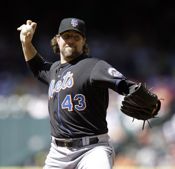 HOUSTON - MAY 14:  Pitcher R.A. Dickey #43  throws against the Houston Astros at Minute Maid Park on May 14, 2011 in Houston, Texas.  (Photo by Bob Levey/Getty Images)