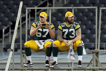 ARLINGTON, TX - FEBRUARY 01:  Nick McDonald #67 and Daryn Colledge #73 of the Green Bay Packers wait for the start of Super Bowl XLV Media Day ahead of Super Bowl XLV at Cowboys Stadium on February 1, 2011 in Arlington, Texas. The Pittsburgh Steelers will