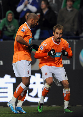 BOLTON, UNITED KINGDOM - NOVEMBER 27: Luke Varney (R) of Blackpool celebrates after scoring the second goal of the game during the Barclays Premier League match between Bolton Wanderers and Blackpool at the Reebok Stadium on November 27, 2010 in Bolton, E