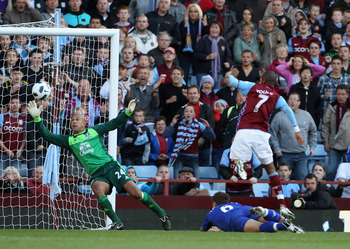 BIRMINGHAM, ENGLAND - AUGUST 29: Tim Howard of Everton  makes a save from a shot by Ashley Young  of Aston Villa during the Barclays Premier League match between Aston Villa and Everton at Villa Park on August 29, 2010 in Birmingham, England.  (Photo by P